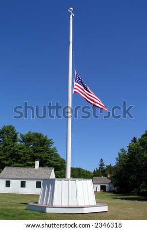 American Flag with blue sky at Half-Mast for Memorial Day - stock photo