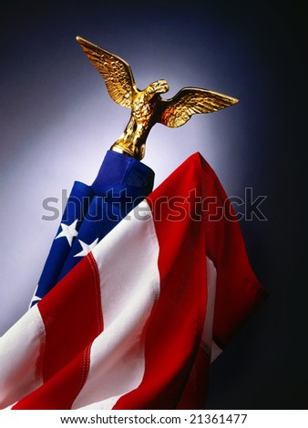 American flag with gold eagle on flagpole