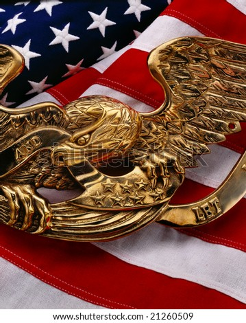 American flag with gold eagle symbol on top - stock photo