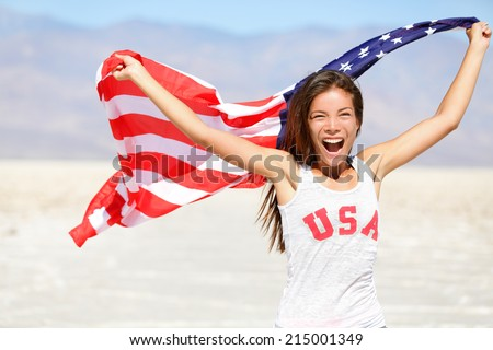 American flag - woman USA sport athlete winner cheering waving US flag Stars and Stripes outdoor running in nature. Beautiful cheering happy young multicultural girl joyful and excited. - stock photo