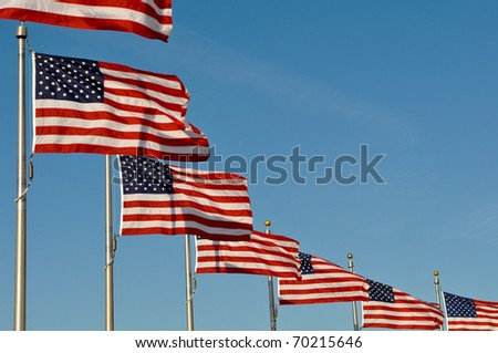 American Flags blowing in the wind at Washington Monument - stock photo