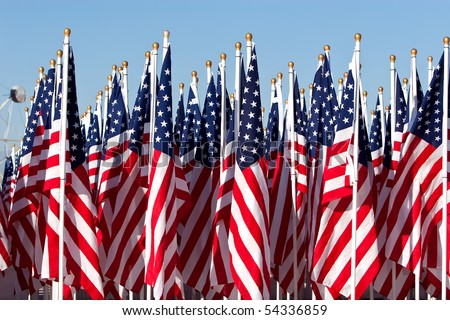 American flags during 4th of July parade - stock photo