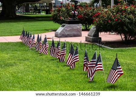 American flags honor firemen who died in fire/Red, White and Blue Flags Honor Firemen who Died on Duty/American flags honor firefighters who died  - stock photo