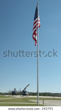 American flags in front of a helipad