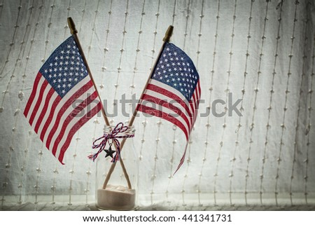 American flags on sheer linen curtain background. July 4th celebration. - stock photo