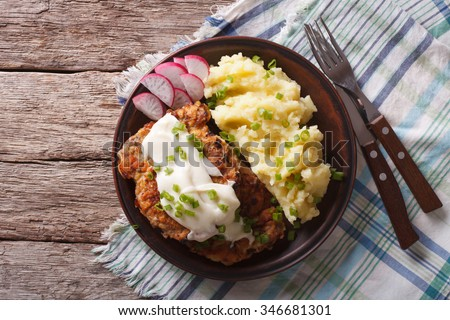 American food: Country Fried Steak and White Gravy on a plate horizontal top view - stock photo