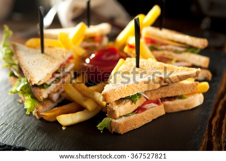American Foods - Classic Club Sandwich with French Fries - stock photo