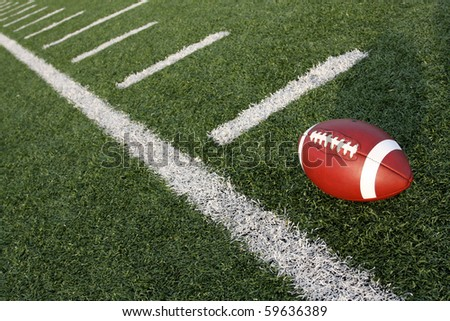 American Football along the hashmarks or yard lines - stock photo