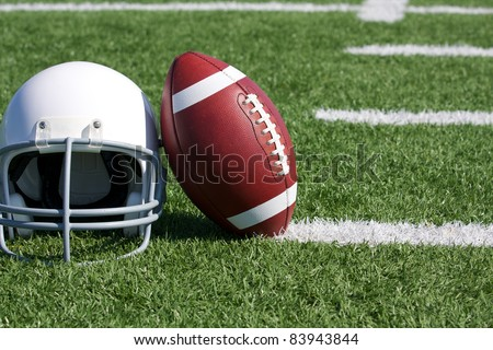 American Football and Helmet on the Field