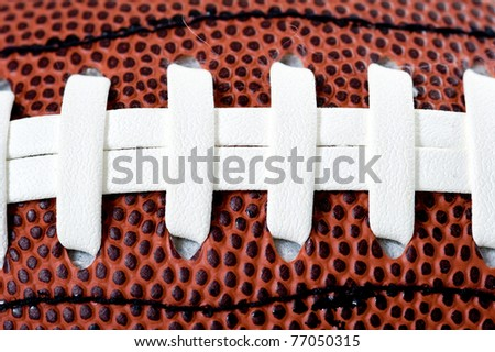 American football ball. Isolated on white background. - stock photo