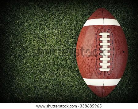 american football ball on grass - stock photo