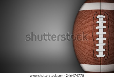 American football ball on gray background. with lots of copy space.