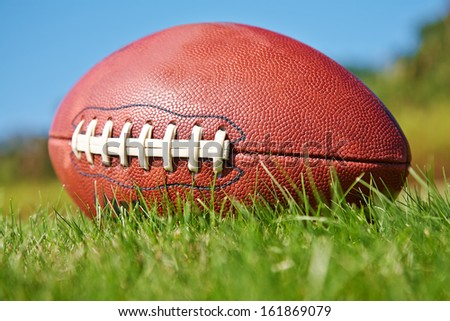 American football ball on the grass