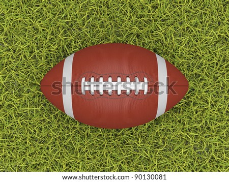 American football ball on the grass field - stock photo