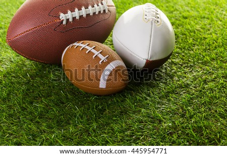 American Football Close up on on green grass.