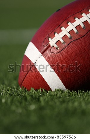 American Football Close Up with Shallow DoF - stock photo