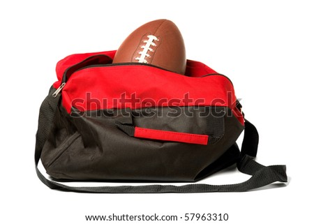 american football coming out of gym bag ready for training - stock photo