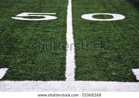 American Football Field at the fifty yard line - stock photo