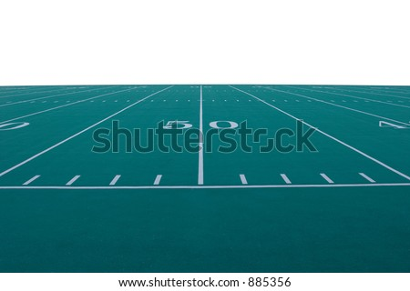 American football field at the 50-yard line.  Field is isolated from background. - stock photo