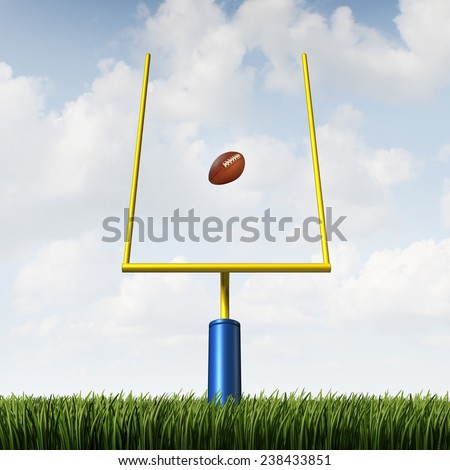 American football field goal concept as a team sport kicked ball going between the posts as a metaphor for offense success and winning strategy concept. - stock photo
