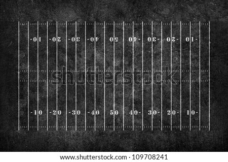 american football field pattern on the dark grunge background - stock photo