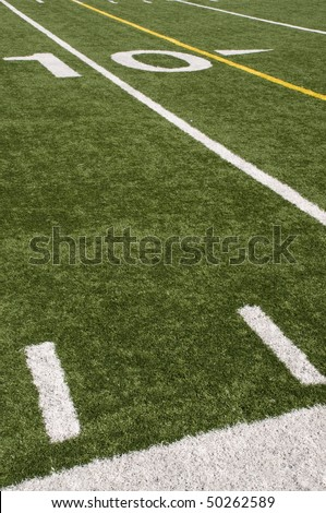 American Football field turf and white painted lines - stock photo