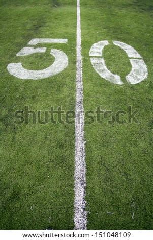 American Football field with Yard Line Beyond - stock photo