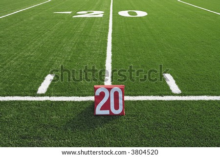 American football field 20 yard line markers. - stock photo