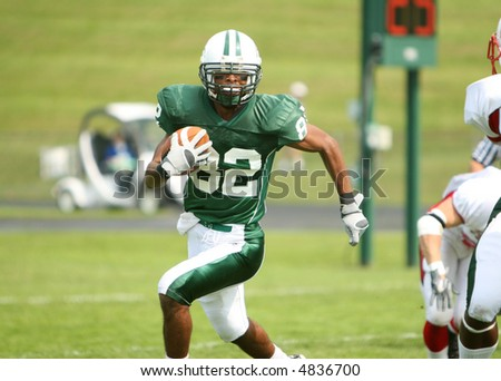 American football game.  Receiver scores winning touchdown