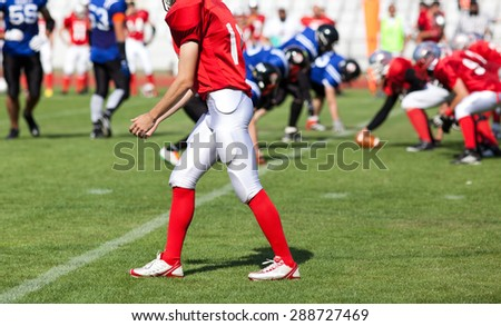 american football game with out of focus players in the background - stock photo
