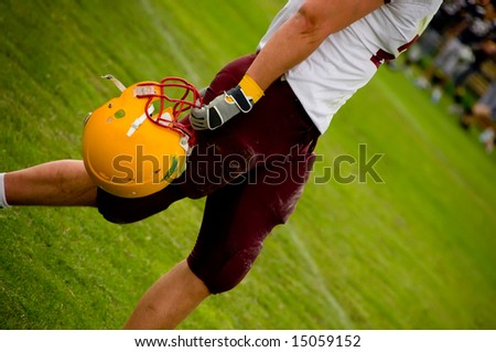 American football helmet in the hand - stock photo