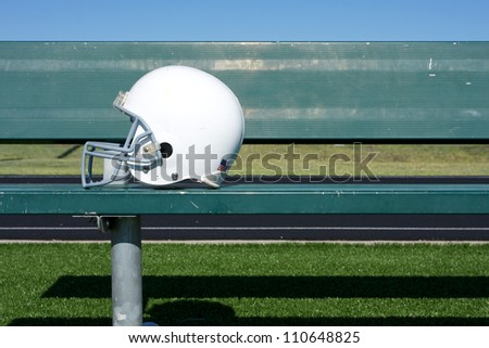 American Football Helmet on the Bench with room for copy - stock photo