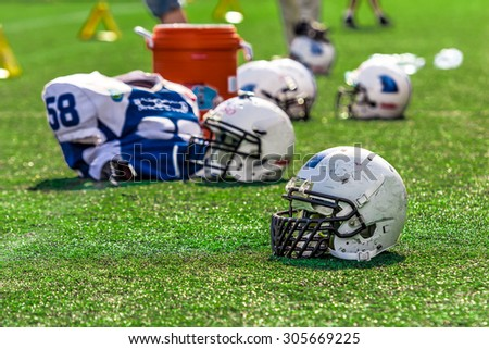 American Football Helmet on the Field - stock photo
