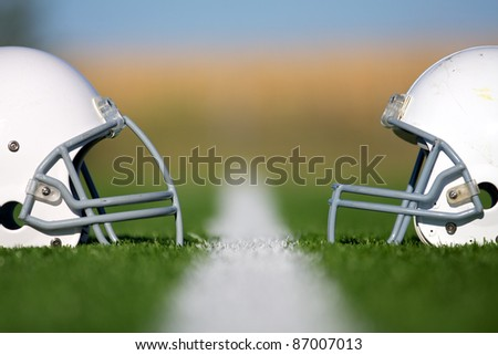 American Football Helmets Faced Off with Shallow Depth of Field - stock photo