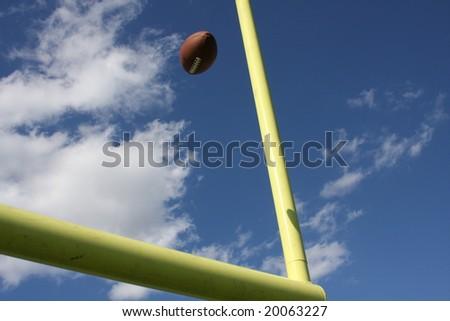 American football kicked through the goal - stock photo