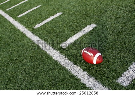 American football near the hashmarks - stock photo
