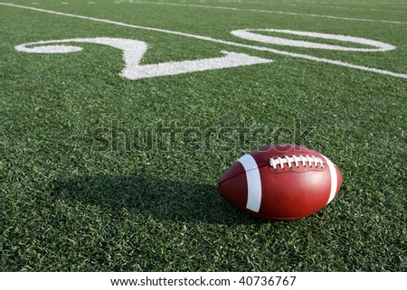 American football near the twenty yard line - stock photo