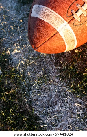 American Football near the yard line on real grass - stock photo