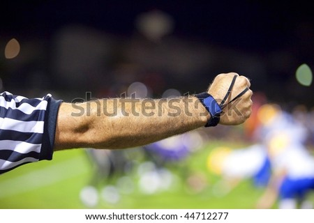 American Football Official or Referee Arm Signal - stock photo