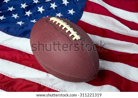 American football on American old glory flag.