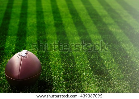 American football on field near yard lines - stock photo