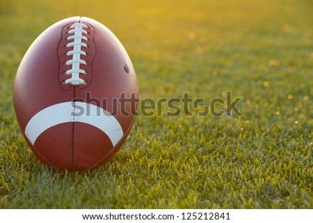 American Football on the Field backlit at Sunset - stock photo