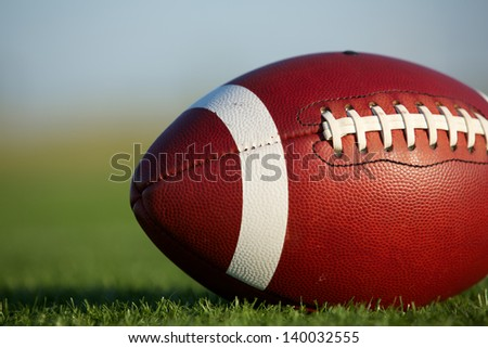American Football on the Field Close Up with room for copy - stock photo