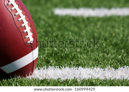 American Football on the Field near the hashmarks - stock photo