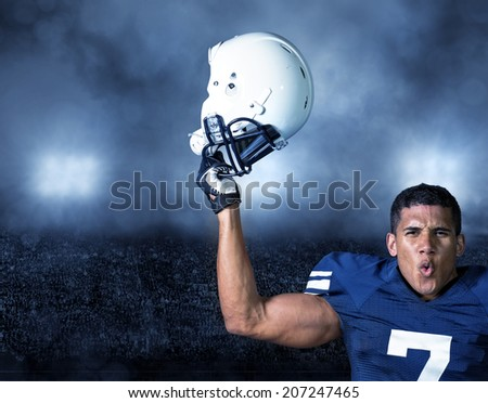 American Football Player celebrating a big win - stock photo