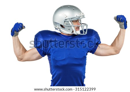 American football player flexing muscles against white background - stock photo