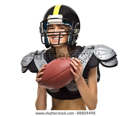 American Football player girl posing with ball - stock photo