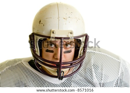 American football player. Headshot through facemask.