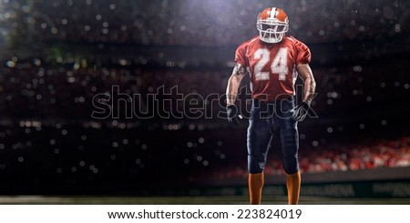 American football player in action before match - stock photo