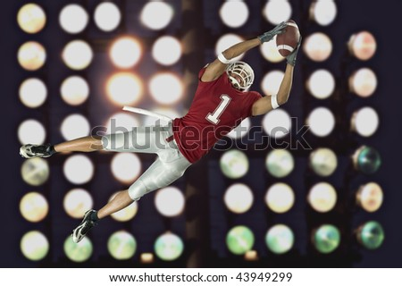 American football player in action with ball - stock photo